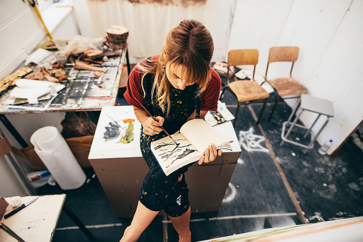 An articles in her workspace drawing a picture