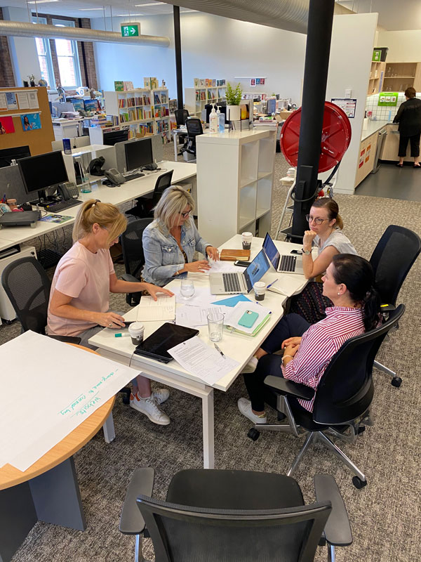 People working in teams in the Hardie Grant Sydney office.