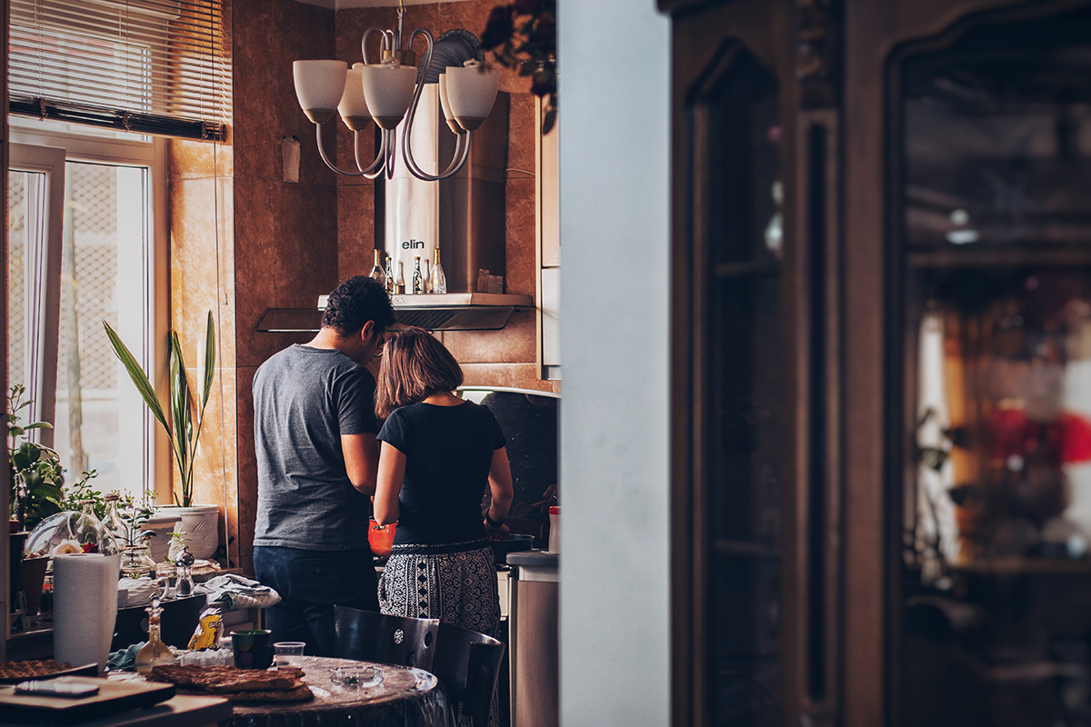 A man and woman in the kitchen