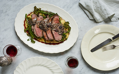 Roasted lamb rump with polenta and creamy olive & anchovy sauce