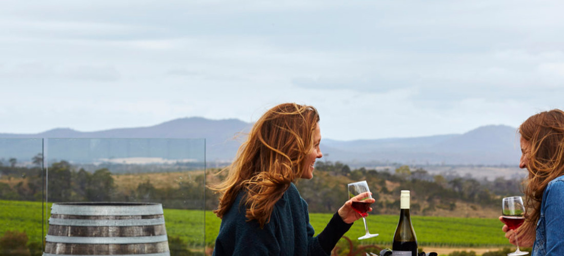 Two people drinking pinot noir at Devil's Corner Tasmania