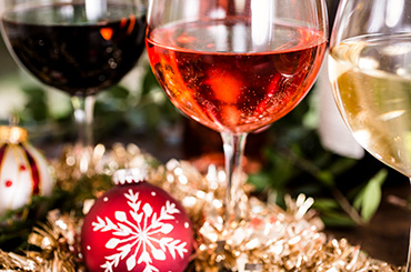 Red, pink and white wine with Christmas decorations