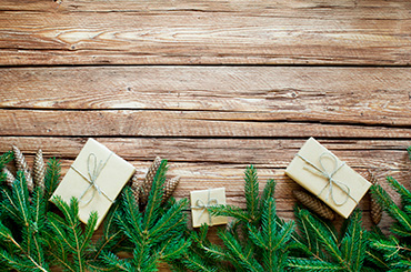 Presents wrapped in brown paper and string with pine leaves