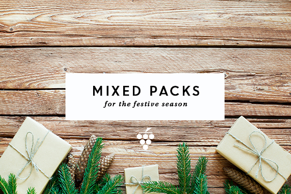 Mixed packs - presents wrapped in brown paper and string surrounded by pine leaves