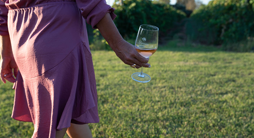 Glass of Yarran Rosé being carried