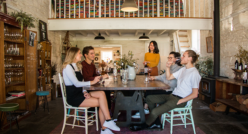Friends around the table at the Hither and Yon cellar door