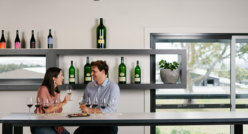 Petaluma cellar door, two people enjoying a wine tasting