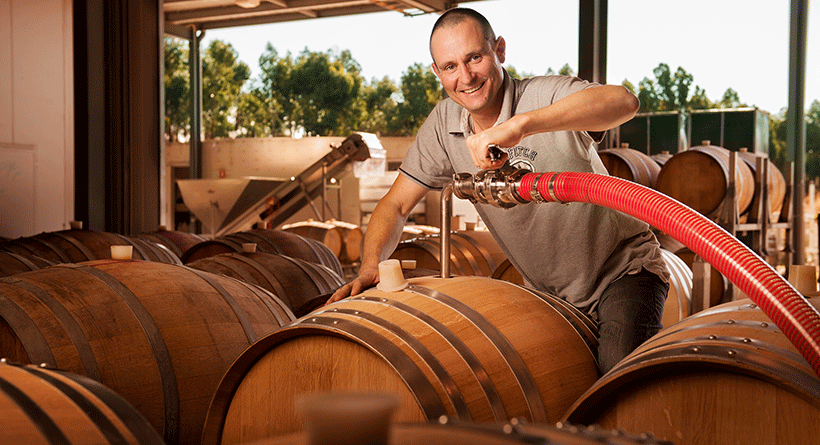Sidewood winemaker Darryl with Barrel of wine